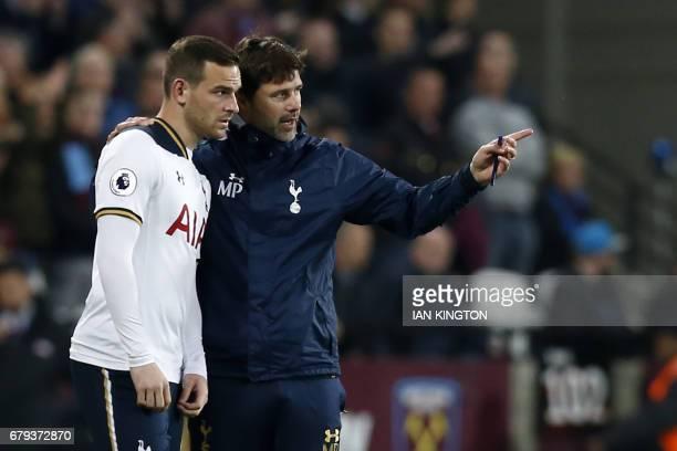 Tottenham Hotspur's Argentinian head coach Mauricio Pochettino speaks to Tottenham Hotspur's Dutch striker Vincent Janssen before sending him on as a...