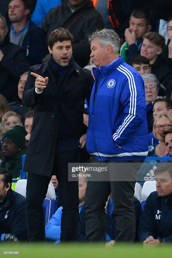 Tottenham Hotspur's Argentinian head coach Mauricio Pochettino (L) talks with Chelsea's Dutch interim manager Guus Hiddink (R) on the touchlinen during the English Premier League football match between Chelsea and Tottenham Hotspur at Stamford Bridge in London on May 2, 2016. / AFP / GLYN KIRK / RESTRICTED TO EDITORIAL USE. No use with unauthorized audio, video, data, fixture lists, club/league logos or 'live' services. Online in-match use limited to 75 images, no video emulation. No use in betting, games or single club/league/player publications. /