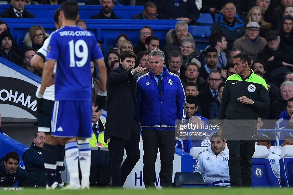 Tottenham Hotspur's Argentinian head coach Mauricio Pochettino (CL) talks with Chelsea's Dutch interim manager Guus Hiddink (CR) on the touchline during the English Premier League football match between Chelsea and Tottenham Hotspur at Stamford Bridge in London on May 2, 2016. / AFP / BEN STANSALL / RESTRICTED TO EDITORIAL USE. No use with unauthorized audio, video, data, fixture lists, club/league logos or 'live' services. Online in-match use limited to 75 images, no video emulation. No use in betting, games or single club/league/player publications. /