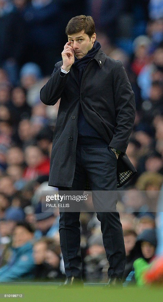 Tottenham Hotspur's Argentinian head coach Mauricio Pochettino watches his players from the touchline during the English Premier League football match between Manchester City and Tottenham Hotspur at the Etihad Stadium in Manchester, north west England, on February 14, 2016. / AFP / PAUL ELLIS / RESTRICTED TO EDITORIAL USE. No use with unauthorized audio, video, data, fixture lists, club/league logos or 'live' services. Online in-match use limited to 75 images, no video emulation. No use in betting, games or single club/league/player publications. /