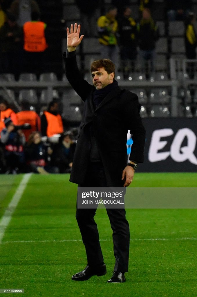 Tottenham Hotspur's Argentinian head coach Mauricio Pochettino waves after the UEFA Champions League Group H football match BVB Borussia Dortmund v Tottenham Hotspur at the BVB Stadion on November 21, 2017 in Dortmund, western Germany. / AFP PHOTO / John MACDOUGALL
