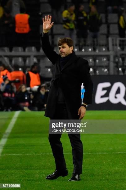 Tottenham Hotspur's Argentinian head coach Mauricio Pochettino waves after the UEFA Champions League Group H football match BVB Borussia Dortmund v...