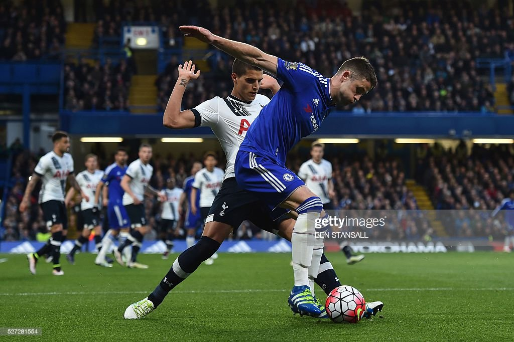Tottenham Hotspur's Argentinian midfielder Erik Lamela (L) pressures Chelsea's English defender Gary Cahill (R) during the English Premier League football match between Chelsea and Tottenham Hotspur at Stamford Bridge in London on May 2, 2016. / AFP / BEN STANSALL / RESTRICTED TO EDITORIAL USE. No use with unauthorized audio, video, data, fixture lists, club/league logos or 'live' services. Online in-match use limited to 75 images, no video emulation. No use in betting, games or single club/league/player publications. /