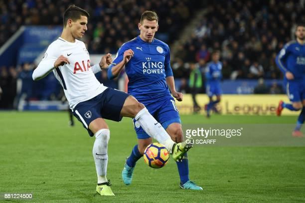 Tottenham Hotspur's Argentinian midfielder Erik Lamela vies with Leicester City's English midfielder Marc Albrighton during the English Premier...