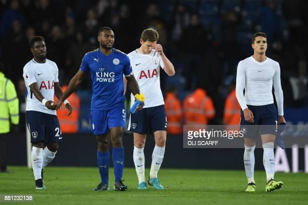 Tottenham Hotspur's Belgian defender Jan Vertonghen and Tottenham Hotspur's Argentinian midfielder Erik Lamela leaves the pitch by Leicester City's...