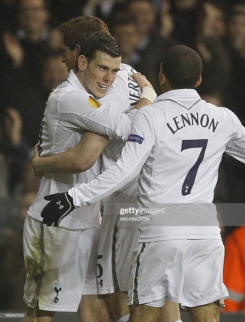Tottenham Hotspur's Belgian defender Jan Vertonghen (2nd L)) celebrates scoring his goal with team-mates Gareth Bale (L) and Aaron Lennon (R) during a UEFA Europa League Round of 16 football match between Tottenham Hotspur and Inter Milan at White Hart Lane in east London, on March 7, 2013.