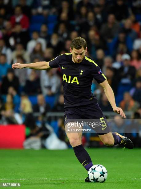 Tottenham Hotspur's Belgian defender Jan Vertonghen runs with the ball during the UEFA Champions League group H football match Real Madrid CF vs...