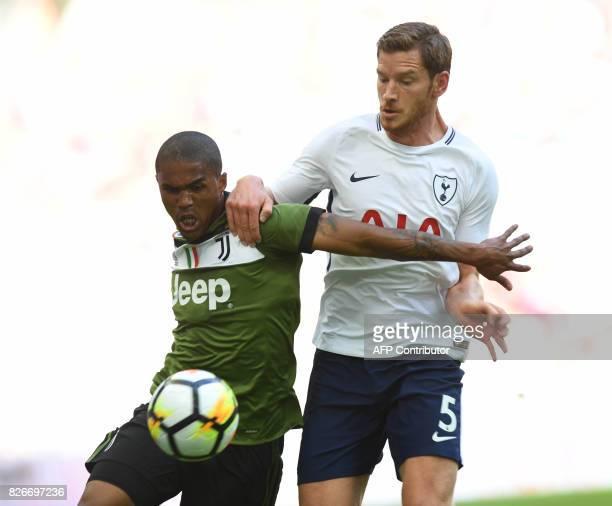 Tottenham Hotspur's Belgian defender Jan Vertonghen vies with Juventus' Brazilian midfielder Douglas Costa during the preseason friendly football...