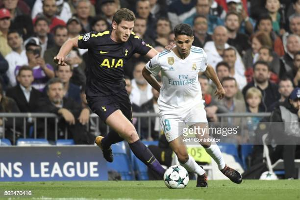 Tottenham Hotspur's Belgian defender Jan Vertonghen vies with Real Madrid's Moroccan defender Achraf Hakimi during the UEFA Champions League group H...