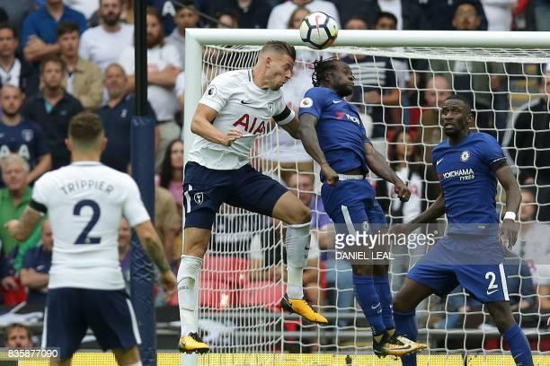 Tottenham Hotspur's Belgian defender Toby Alderweireld beats Chelsea's Nigerian midfielder Victor Moses in the air during the English Premier League...