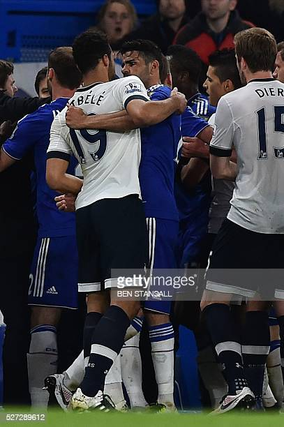 Tottenham Hotspur's Belgian midfielder Mousa Dembele and Chelsea's Brazilianborn Spanish striker Diego Costa clash during the English Premier League...