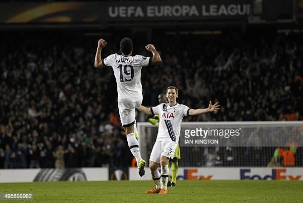 Tottenham Hotspur's Belgian midfielder Mousa Dembele celebrates scoring his team's second goal with Tottenham Hotspur's Belgian defender Jan...