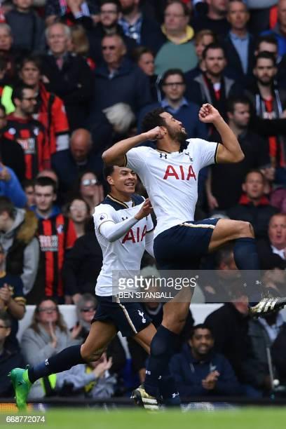 Tottenham Hotspur's Belgian midfielder Mousa Dembele celebrates with Tottenham Hotspur's English midfielder Dele Alli after scoring the opening goal...