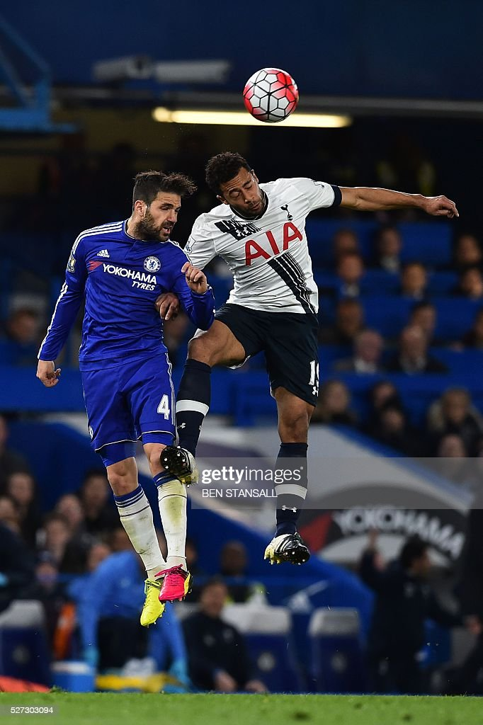 Tottenham Hotspur's Belgian midfielder Mousa Dembele (R) goes up against Chelsea's Spanish midfielder Cesc Fabregas (L) for a high ball during the English Premier League football match between Chelsea and Tottenham Hotspur at Stamford Bridge in London on May 2, 2016. / AFP / BEN STANSALL / RESTRICTED TO EDITORIAL USE. No use with unauthorized audio, video, data, fixture lists, club/league logos or 'live' services. Online in-match use limited to 75 images, no video emulation. No use in betting, games or single club/league/player publications. /