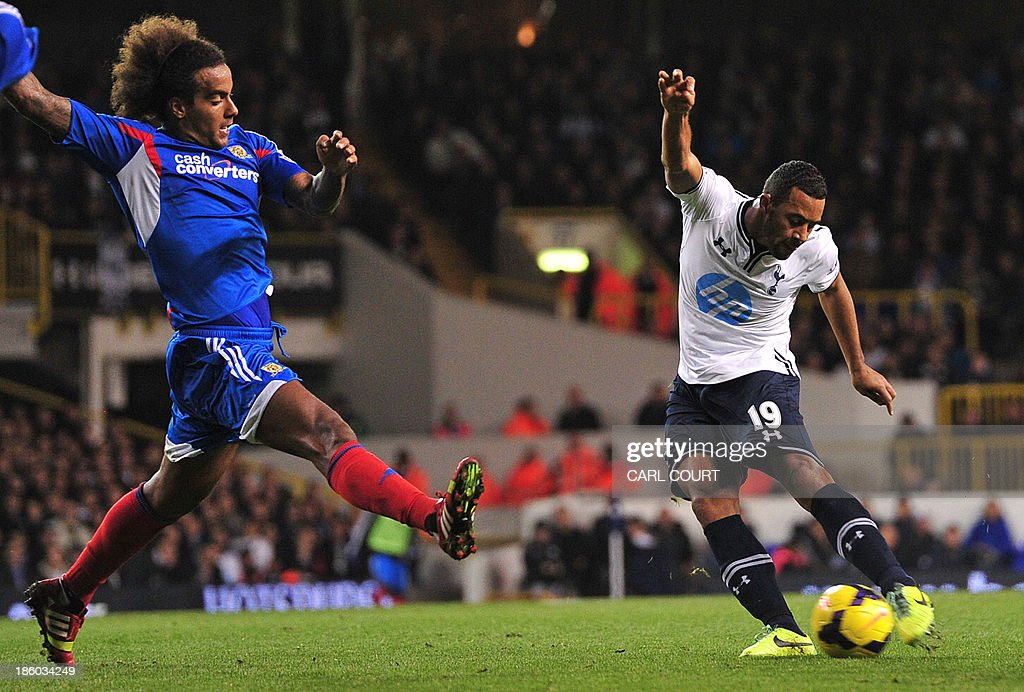 Tottenham Hotspur's Belgian midfielder Mousa Dembele (R) shoots as Hull City's English midfielder Tom Huddlestone closes in during the English Premier League football match between Tottenham Hotspur and Hull City at White Hart Lane in north London on October 27, 2013. Tottenham won the game 1-0. USE. No use with unauthorized audio, video, data, fixture lists, club/league logos or live services. Online in-match use limited to 45 images, no video emulation. No use in betting, games or single club/league/player publications.