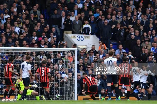 Tottenham Hotspur's Belgian midfielder Mousa Dembele shoots to score the opening goal of the English Premier League football match between Tottenham...