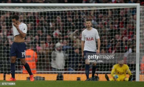 Tottenham Hotspur's Belgian midfielder Mousa Dembele Tottenham Hotspur's English defender Eric Dier and Tottenham Hotspur's French goalkeeper Hugo...