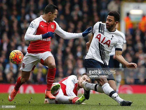 Tottenham Hotspur's Belgian midfielder Mousa Dembele vies with Arsenal's Welsh midfielder Aaron Ramsey and Arsenal's Chilean striker Alexis Sanchez...