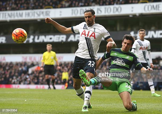 Tottenham Hotspur's Belgian midfielder Nacer Chadli vies with Swansea City's English midfielder Jack Cork during the English Premier League football...