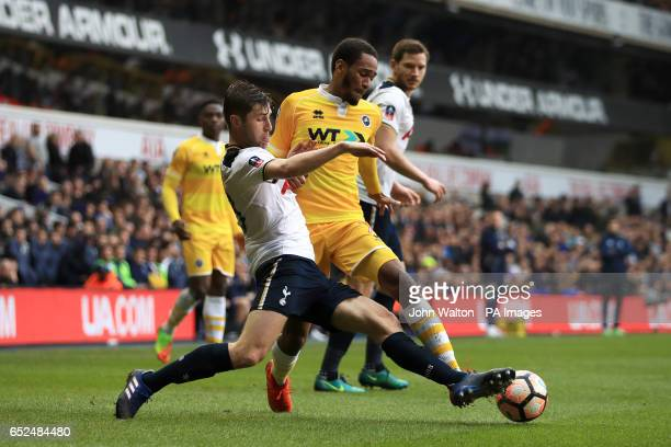 Tottenham Hotspur's Ben Davies and Millwall's Shaun Cummings battle for the ball during the Emirates FA Cup Quarter Final match at White Hart Lane...