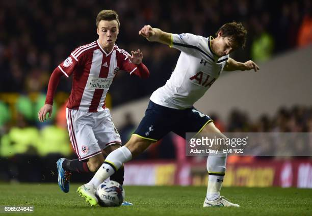 Tottenham Hotspur's Benjamin Stambouli and Sheffield United's StefanScougall battle for the ball