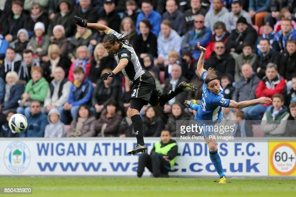 Tottenham Hotspur's Benoit AssouEkotto and Wigan Athletic's Ronnie Stam battle for the ball