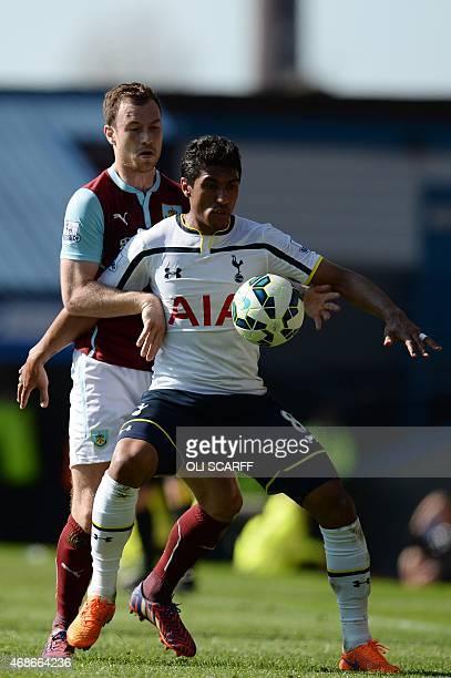 Tottenham Hotspur's Brazilian midfielder Paulinho controls the ball under pressure from Burnley's English striker Ashley Barnes during the English...