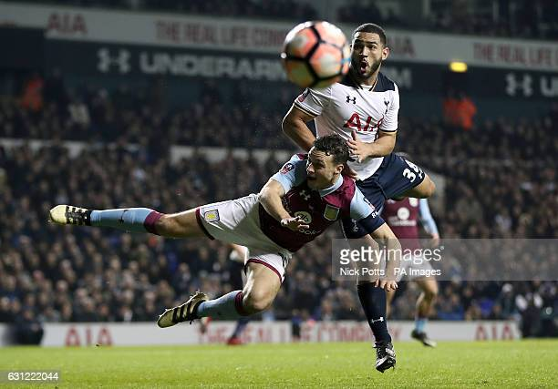 Tottenham Hotspur's Cameron CarterVickers ans Aston Villa's James Chester battle for the ball during the Emirates FA Cup Third Round match at White...