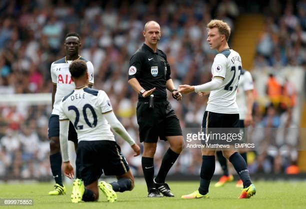 Tottenham Hotspur's Christian Eriksen argues with referee Robert Madley