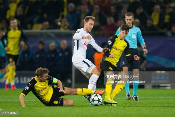 Tottenham Hotspur's Christian Eriksen is tackled by Borussia Dortmund's Marcel Schmelzer during the UEFA Champions League group H match between...