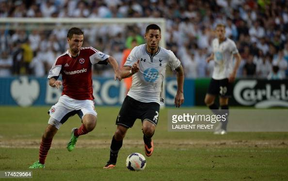Tottenham Hotspur's Clint Dempsey dribbes the ball past South China's Carlos Augusto Bertoldi during their Barclays Asia trophy third place football...