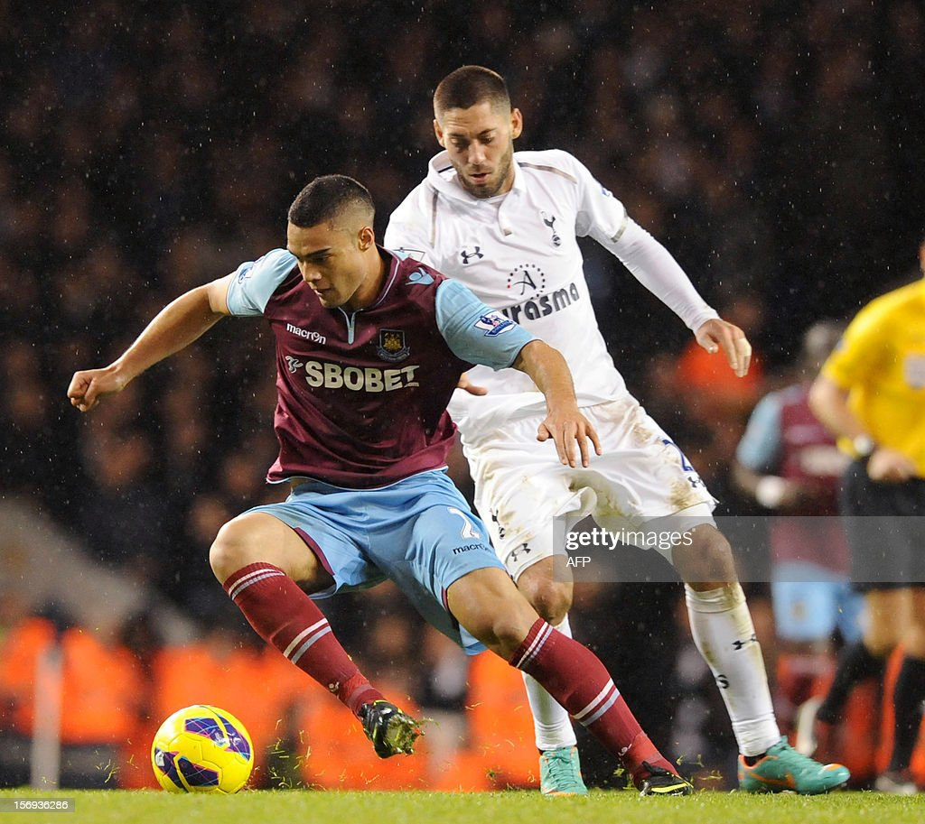 """Tottenham Hotspur's Clint Dempsey (R) vies with West Ham's Winston Reid during their English Premier League football match at White Hart Lane in North London, England, on 25 November, 2012. Tottenham Hotspur won the match 3-1. USE. No use with unauthorized audio, video, data, fixture lists, club/league logos or """"live"""" services. Online in-match use limited to 45 images, no video emulation. No use in betting, games or single club/league/player publications."""