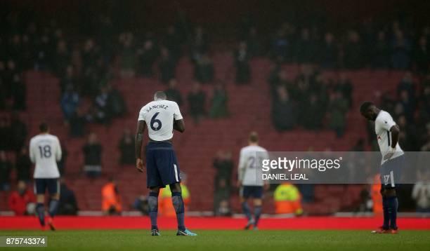 Tottenham Hotspur's Colombian defender Davinson Sanchez and Tottenham Hotspur's French midfielder Moussa Sissoko react following the English Premier...