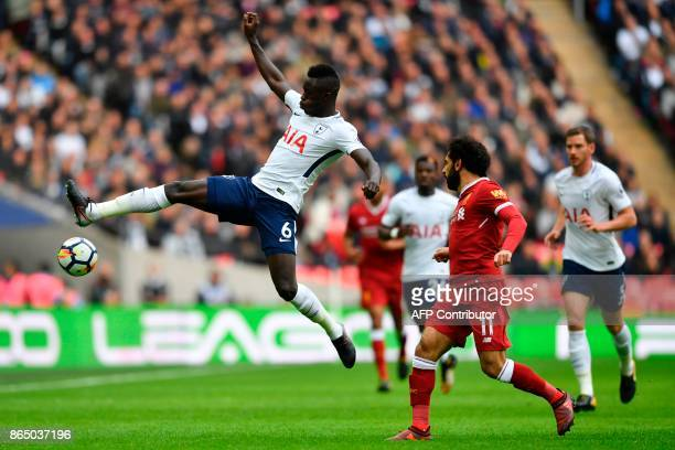 Tottenham Hotspur's Colombian defender Davinson Sanchez jumps to control the ball during the English Premier League football match between Tottenham...
