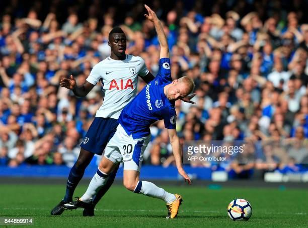 Tottenham Hotspur's Colombian defender Davinson Sanchez vies with Everton's Dutch midfielder Davy Klaassen during the English Premier League football...