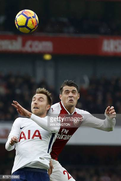 Tottenham Hotspur's Danish midfielder Christian Eriksen and Arsenal's Swiss midfielder Granit Xhaka vie during the English Premier League football...