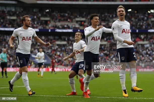 Tottenham Hotspur's Danish midfielder Christian Eriksen celebrates with Tottenham Hotspur's English midfielder Dele Alli and Tottenham Hotspur's...