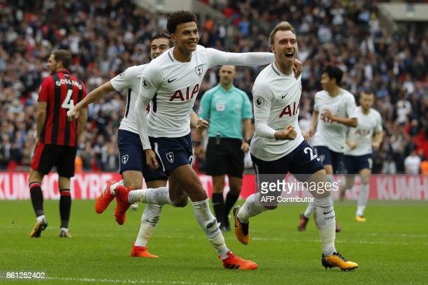 Tottenham Hotspur's Danish midfielder Christian Eriksen celebrates with Tottenham Hotspur's English midfielder Dele Alli scoring the team's first...