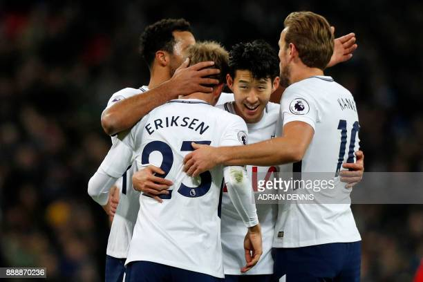 Tottenham Hotspur's Danish midfielder Christian Eriksen celebrates with teammates after scoring their fifth goal during the English Premier League...