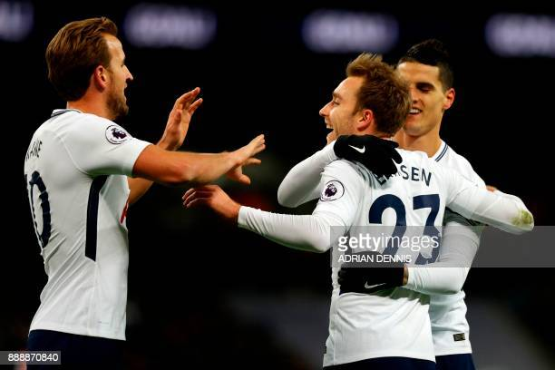 Tottenham Hotspur's Danish midfielder Christian Eriksen celebrates with Tottenham Hotspur's English striker Harry Kane and Tottenham Hotspur's...
