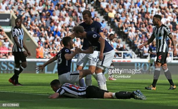 Tottenham Hotspur's Danish midfielder Christian Eriksen congratulates Tottenham Hotspur's Welsh defender Ben Davies after he scored their second goal...
