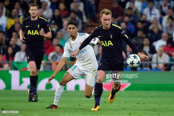 Tottenham Hotspur's Danish midfielder Christian Eriksen controls the ball next to Real Madrid's Moroccan defender Achraf Hakimi during the UEFA...