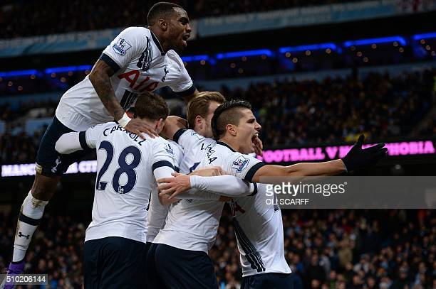 Tottenham Hotspur's Danish midfielder Christian Eriksen is mobbed by teammates as he celebrates scoring his team's second goal during the English...