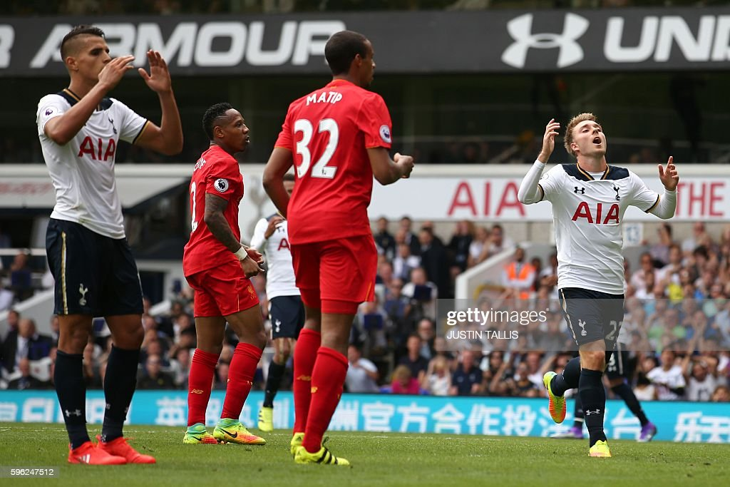 Tottenham Hotspur's Danish midfielder Christian Eriksen (R) reacts after missing a shot on goal during the English Premier League football match between Tottenham Hotspur and Liverpool at White Hart Lane in London, on August 27, 2016. / AFP / JUSTIN TALLIS / RESTRICTED TO EDITORIAL USE. No use with unauthorized audio, video, data, fixture lists, club/league logos or 'live' services. Online in-match use limited to 75 images, no video emulation. No use in betting, games or single club/league/player publications. /