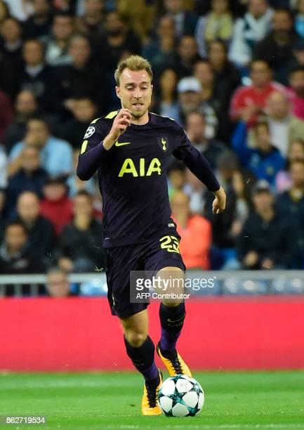 Tottenham Hotspur's Danish midfielder Christian Eriksen runs with the ball during the UEFA Champions League group H football match Real Madrid CF vs...