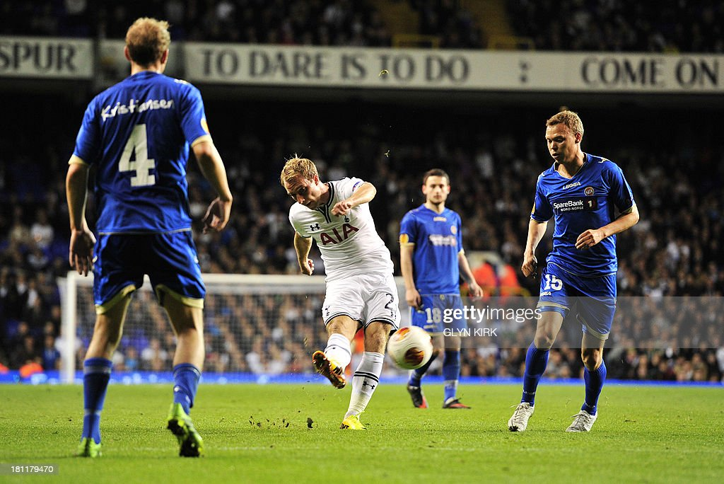 Tottenham Hotspur's Danish midfielder Christian Eriksen (C) scores their third goal during the UEFA Europa League group K football match between Tottenham Hotspur and Tromso at White Hart Lane, London, on September 19, 2013. Tottenham won 3-0.
