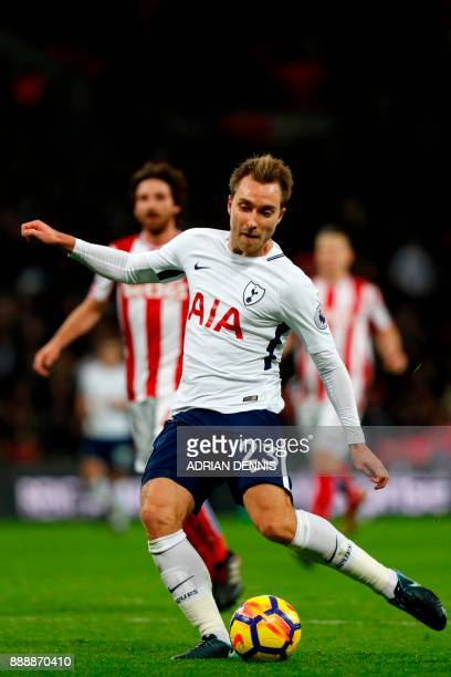 Tottenham Hotspur's Danish midfielder Christian Eriksen shoots to score their fifth goal during the English Premier League football match between...