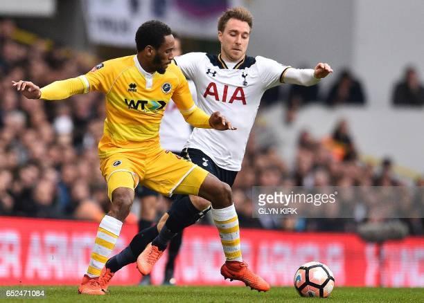 Tottenham Hotspur's Danish midfielder Christian Eriksen vies with Millwall's Englishborn Jamaican defender Shaun Cummings during the English FA Cup...