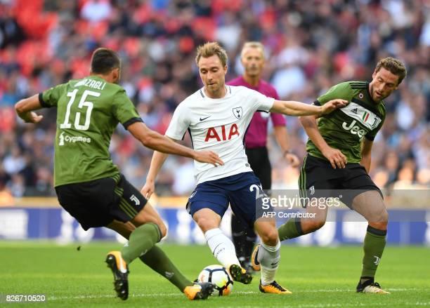 Tottenham Hotspur's Danish midfielder Christian Eriksen vies with Juventus' Italian defender Andrea Barzagli and Juventus' Italian midfielder Claudio...