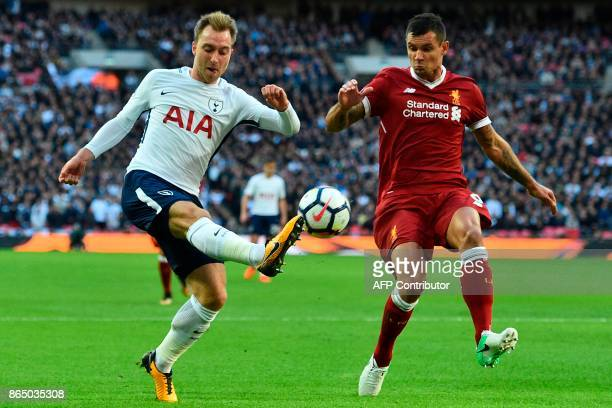 Tottenham Hotspur's Danish midfielder Christian Eriksen vies with Liverpool's Croatian defender Dejan Lovren during the English Premier League...